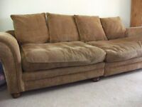 Sofa, seats four adults, brown.