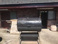 Hog roast charcoal barbeque