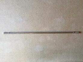 2 extendable curtain poles with matching hold backs
