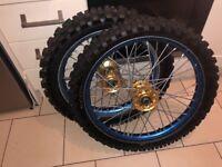 Suzuki rmz blue excel wheels