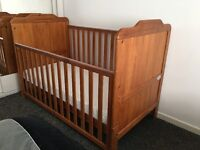 Cotbed with mattress (ex McCulloughs Bangor) and assortment of bed clothes for sale.