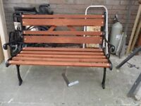 cast iron and wooden bench
