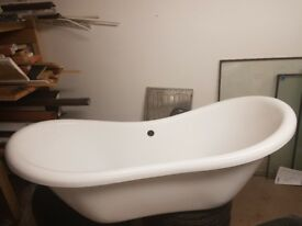 white freestanding bathtub with silver legs