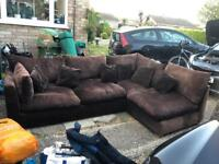 Chocolate corner sofa and large pouffe