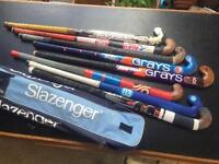 Collection of 8 used hockey sticks, with a Slazenger carry case