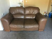 Two 2 seater tan leather sofas and storage foot stool
