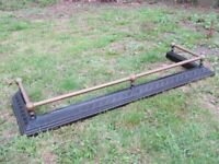 VINTAGE CAST IRON AND BRASS FIRE FENDER