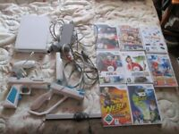 WII CONSOLE BUNDLE 8 GAMES WHICH ARE MARIO & SONIC AT THE OLYMPIC GAMES,BEN 10 ALIEN FORCE ETC