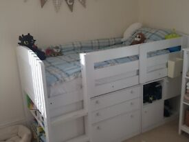 Mid Sleeper Cabin bed with all the storage you need for a small room.