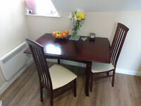 A beautiful dining table and chairs