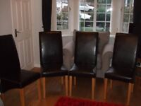 Four Faux Leather Dining Chairs.
