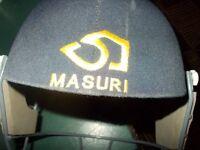 2 masuri cricket helmets