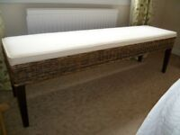 Rattan bench with cream upholstered fixed cushion-stylish and excellent condition