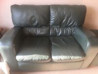 Green leather suite consisting of 2 seater sofa, 2 armchairs and footstool. Good condition