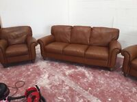 Tan brown 3 seater and two chairs
