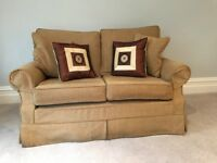 Small Two seater sofa for sale . Very good condition with spare set of made to measure covers