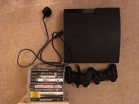 PS3 with 2 controllers and 5 games with box