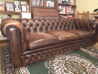 Leather Chesterfield suite, brown with footstool.