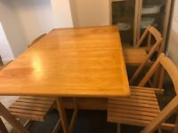 Wooden extending table and 4 folding chairs + option of additional tablecloth