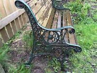 WOODEN BENCH WITH ORNATE DECORATIVE CAST IRON ENDS