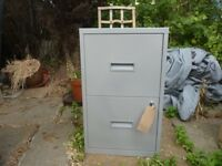 small metal filing cabinet with 2 drawers and 2 keys