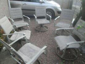 matching set outdoor sturdy design deck / garden table and 6 swivel rocking deck / garden chairs