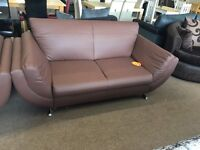 3 + 2 brown faux leather sofas, slight damage sold as seen