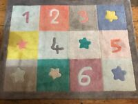 Lovely children's rug from Verbaudet - colourful with numbers.