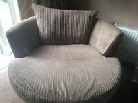 Large. 2 seater sofa with 1 large swivel cuddle chairs