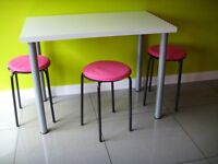 Ikea White kitchen dining table + 3 stools and seat covers in VGC from pet & smoke free home