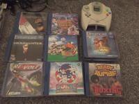 Sega Dreamcast plus games and control pad