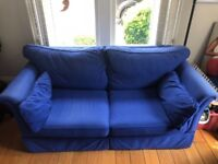 ROYAL BLUE SOFA FOLD OUT TO DOUBLE BED with large royal blue foot stool