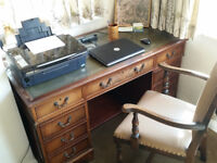 Desk, DESK. Mahogany Repro. 7 drawers incl 2 deep. Thirty + years old. Deliver in Guildford possible