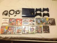 PS3 Super Slim Limited Edition Blue. 4 Genuine PS wireless controllers. Loads of Games