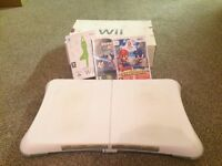 Wii Console, Wii Fit Board and 3 games