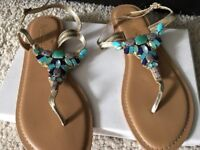 Golden sandals with blue beads size 5