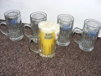 4 Vintage Harp lager Glasses and a Harp lager Glass with a candle that looks like a glass of lager.