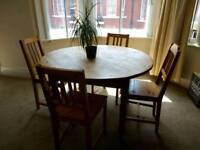 Round wooden dining table and chairs