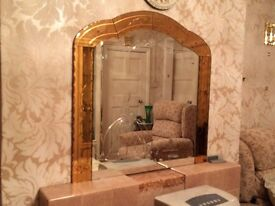 Mirror with peach colour glass surround and engraved lady