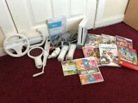 Nintendo Wii Console - 2 remotes, all leads + 8 games and extra accessories