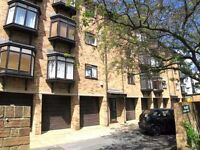 SPACIOUS 2 BEDROOM APARTMENT WITH ITS OWN GARAGE!