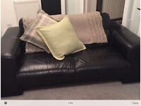 Black leather two seater sofa good condition
