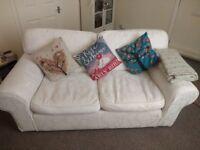 Free two seater sofa.