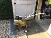 3 HP Briggs and Stratton Rotovator plus accessory's in good working order