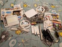 Nintendo wii with 3 controllers 2 steering wheels 2 nunchucks and more