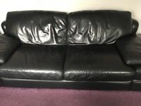 Two black leather sofas from Sofology