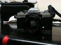 Minolta XG-M film camera with a 50mm lens.