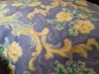 Absolutely lovely blue and yellow flower pattern curtains. Bright and lively.