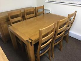 Solid oak dining table, 6 chairs and matching sideboard