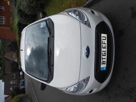 A beautiful and well-maintained crystal white Ford KA 2012 with only 16,500 miles!
